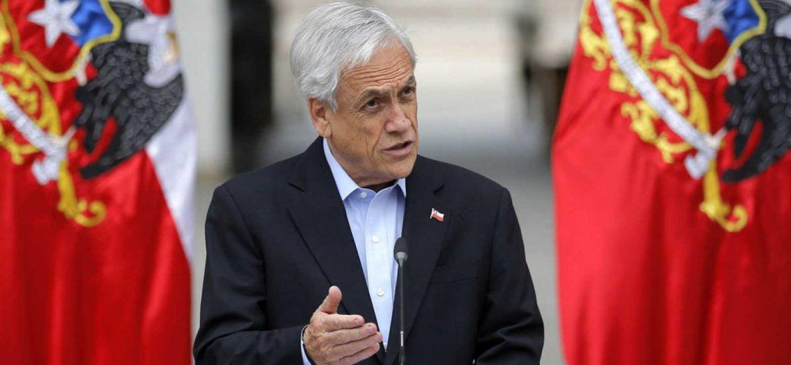 Piñera quiere prohibir a encapuchados